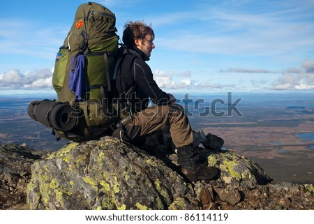 Hiker on the top of the Mountain - stock photo