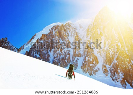 Hiker on the trek in Himalayas - stock photo