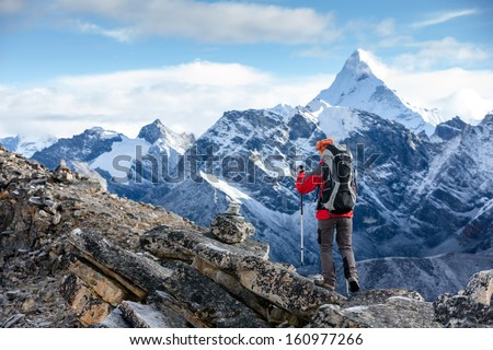 Hiker posing at camera on the trek in Himalayas, Nepal