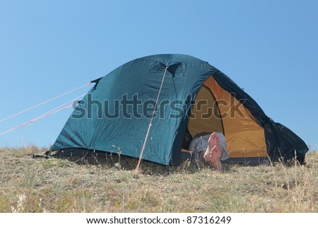 Hiker resting in a tent