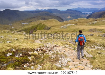Hiker returning from Scafell via Esk Hause in the Lake District.