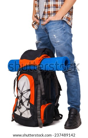 Hiker standing with knapsack - stock photo