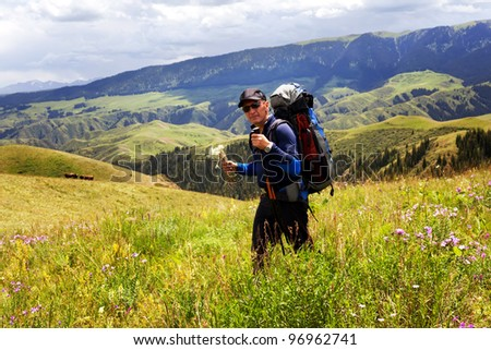 Hiker stopping to smell the wildflowers