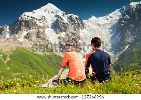 Hiker take a rest during hiking in Caucasus mountains, Georgia - stock photo
