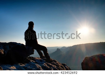 Hiker take a rest in nature.  Mountain summit above forest in valley. Traveling in European  natural parks. - stock photo
