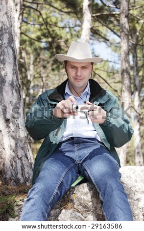 Hiker taking photo with mobile phone - stock photo