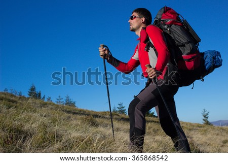 Hiker trekking in the mountains. - stock photo