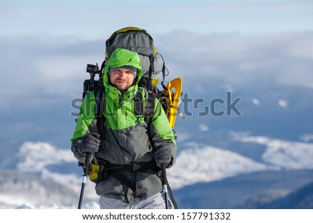 Hiker walking in winter Carpathian mountains - stock photo