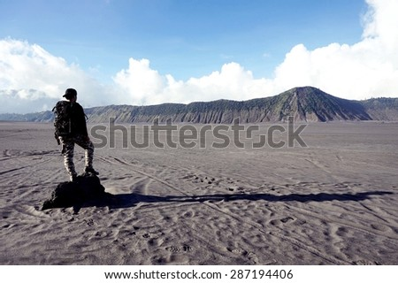 hiker with backpack stand on the rock, and view scenery - stock photo