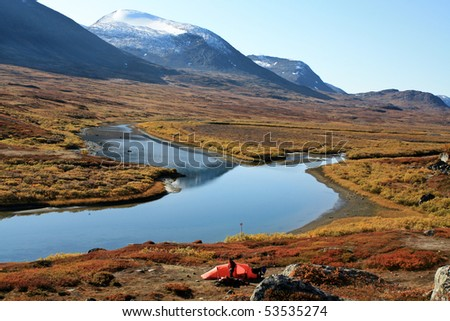 Hiker with Tent on the Kungsleden in Lapland - Sweden - stock photo