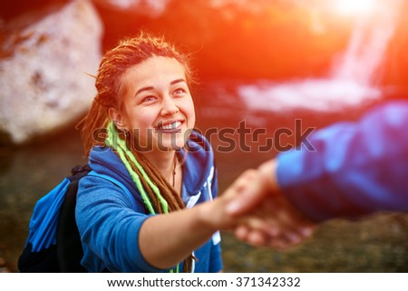 hiker woman getting help - stock photo