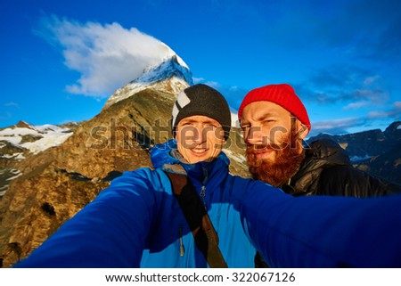 hikers  at the top of a pass  making selfie against  the Matterhorn mount, Switzerland