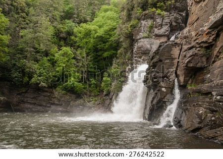 Hikers can get a river level view of Linville Falls in this National Park - stock photo