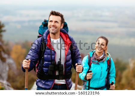 Hikers enjoy the view looking at rocks of Jura, Poland - stock photo
