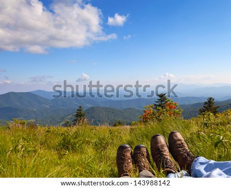 Hikers enjoying the view - stock photo