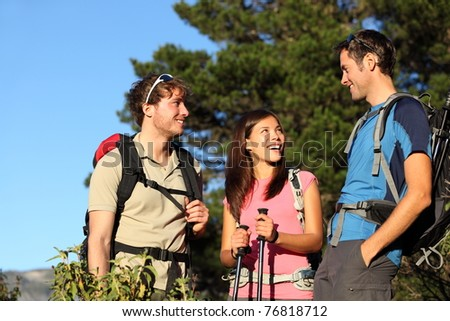 Hikers. Group of friends hiking and relaxing during hike in forest. Outdoors people enjoying and having fun on Tenerife, Canary Islands, Spain - stock photo