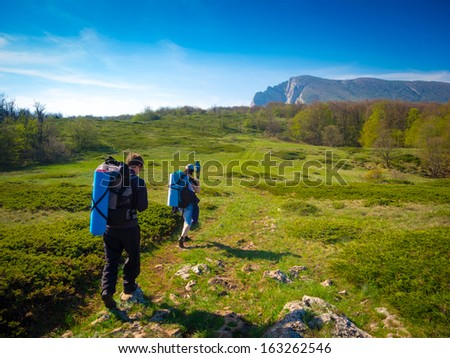 Hikers group trekking in Crimea mountains