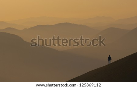 Hikers in the mountains of Gipuzkoa views from the top of Mount Ernio. - stock photo