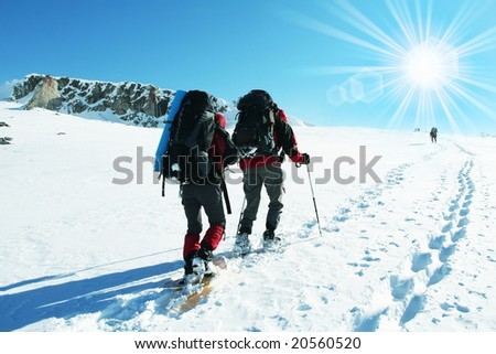 hikers in winter mountain - stock photo