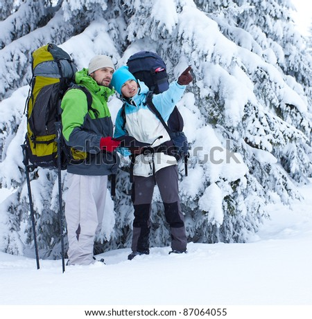Hikers look the way with the map - stock photo