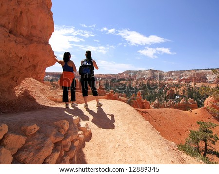 Hikers looking at landscape in Bryce Canyon national park, Utah, USA - stock photo