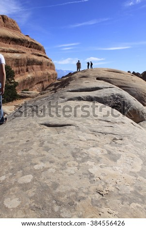 Hikers on The Fins, Arches National Park - stock photo