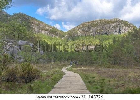 Hikers returning from Pulpit Rock (Preikestolen) in Norway - stock photo