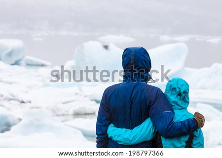 Hikers standing and enjoying glaicer view - stock photo