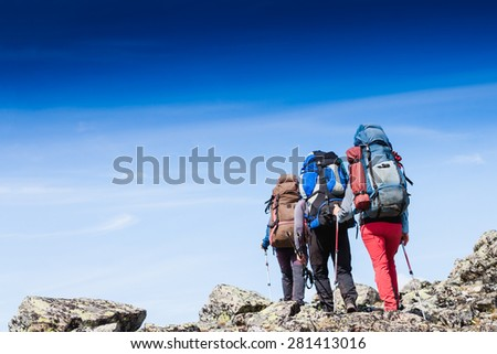 Hikers team trekking in Crimea mountains - stock photo