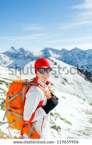 Hiking and walking woman, success and freedom in mountains. Fitness and healthy lifestyle outdoors in winter nature. Female mountaineer, climber on mountain ridge in Tatras, Poland. - stock photo