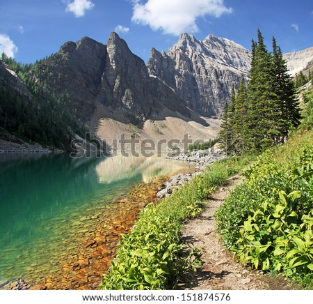 Hiking at Lake Louise, Banff National Park, Alberta, Canada Trail to the Beehive and beyond. Lake Agnes and Mount Whyte - stock photo