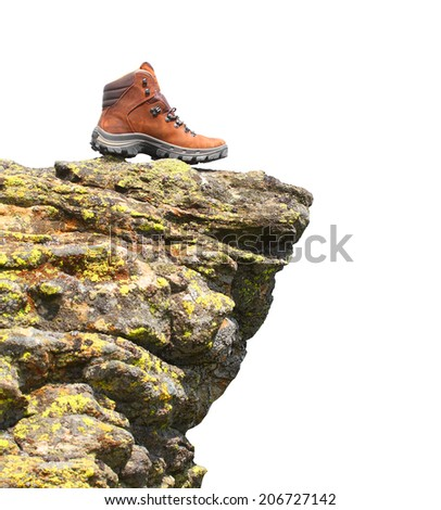Hiking boots on the rock with space for your text. - stock photo