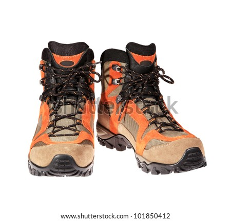 Hiking boots on the white background - stock photo