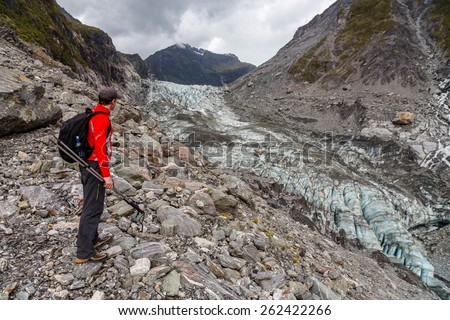 Hiking by the Fox glacier in South Alps, South island of New Zealand - stock photo