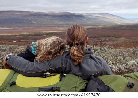 hiking couple takes a break - stock photo