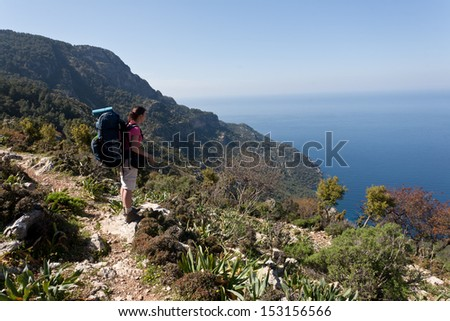 Hiking girl in Turkey, looking at the sea.