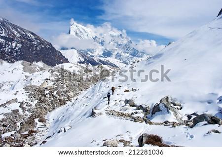 Hiking group on a  trail. Ngozumba Glacier, Sagarmatha National Park, Nepal, Himalayas  - stock photo