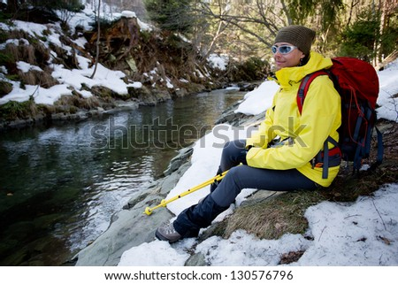 Hiking, Hiker in spring mountains - woman on hike - stock photo