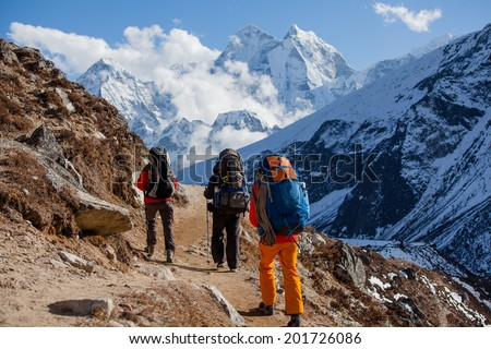 Hiking in Himalaya mountains - stock photo