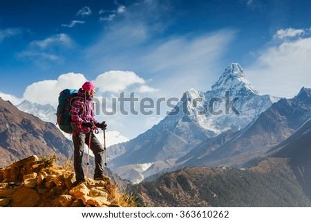 Hiking in Himalaya mountains. Woman Traveler with Backpack hiking in the Mountains. mountaineering sport lifestyle concept  - stock photo
