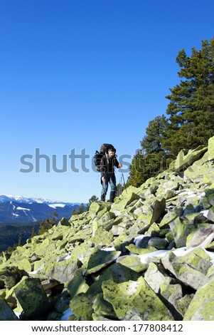 hiking in the mountains. - stock photo