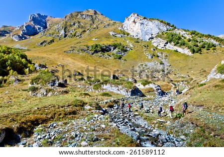 Hiking in the mountains .  Picture was taken during trekking hike in the beautiful and scenic Caucasus mountains at autumn, Arhiz region, Abishira-Ahuba range, Karachay-Cherkessia, Russia - stock photo