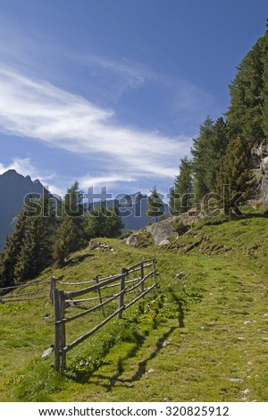 Hiking in the Oetztal Alps high above the village Laengenfeld - stock photo