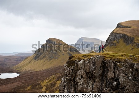 Hiking in the Quairing Mountains on the Isle of Skye in Scotland - stock photo