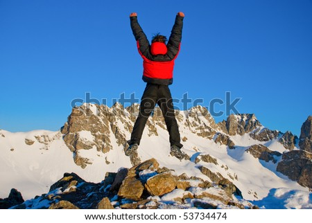 hiking in the winter mountains - stock photo