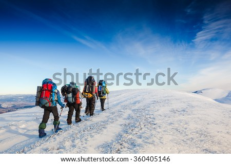 hiking in winter mountains. People traveling and sport concept - stock photo
