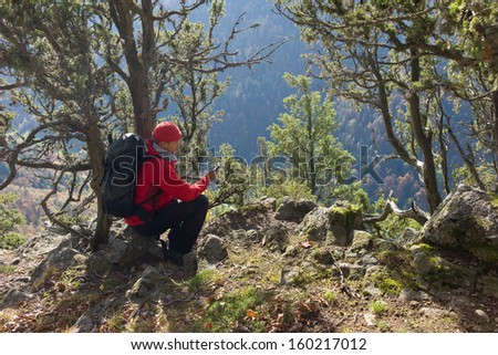 hiking man with gps, Black Forest, Germany - stock photo