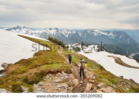 Hiking on mount Rainier at summer - stock photo