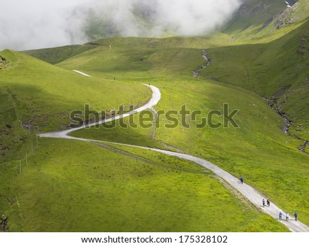 Hiking path from First to the Bachalpsee, Grindelwald, Switzerland. - stock photo