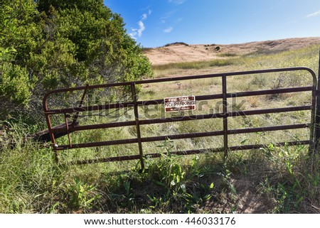 Hiking path to hills with gate sign of Fire Trail No Parking. - stock photo